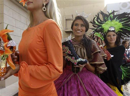 "<div class=""meta ""><span class=""caption-text "">Miss America contestants, from left, Jaclyn Raulerson, Miss Florida, Christina McCauley, Miss Georgia, and Jalee Fuselier, Miss Hawaii, wait to go on stage during the ""Show Us Your Shoes"" parade Friday, Jan. 14, 2011 in Las Vegas. (AP Photo/Julie Jacobson) (AP Photo/ Julie Jacobson)</span></div>"