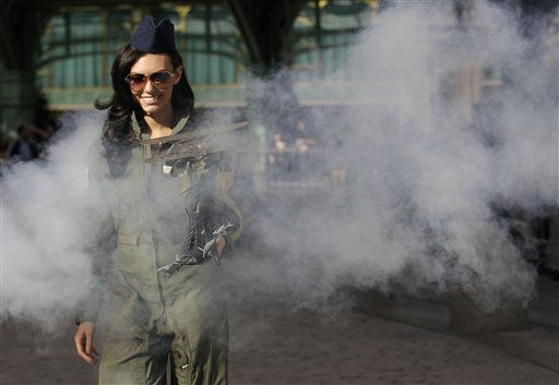 "<div class=""meta ""><span class=""caption-text "">Miss America contestant, Becky Minger, Miss Ohio, walks through manufactured smoke during a photo shoot after the ""Show Us Your Shoes"" parade, Friday, Jan. 14, 2011 in Las Vegas. (AP Photo/Julie Jacobson) (AP Photo/ Julie Jacobson)</span></div>"