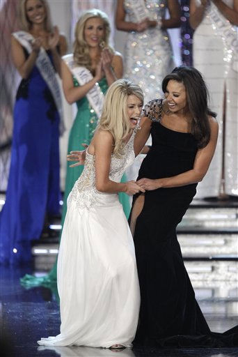 "<div class=""meta ""><span class=""caption-text "">Teresa Scanlan, Miss Nebraska, left, reacts with Alyse Eady, Miss Arkansas after being named Miss America 2011 during the Miss America pageant, Saturday, Jan. 15, 2011 in Las Vegas. (AP Photo/Julie Jacobson) (AP Photo/ Julie Jacobson)</span></div>"