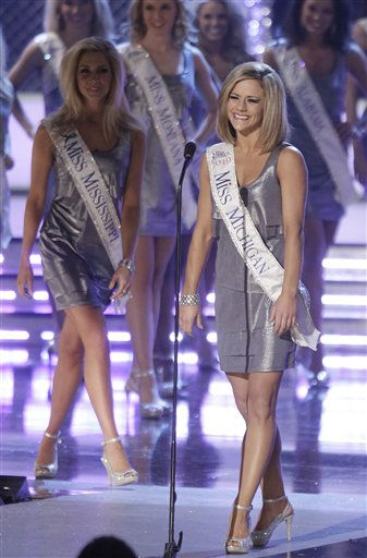 "<div class=""meta ""><span class=""caption-text "">Miss Michigan, Katie Lynn LaRoche, introduces herself at the start of the Miss America pageant, Saturday, Jan. 15, 2011 in Las Vegas. (AP Photo/Julie Jacobson) (AP Photo/ Julie Jacobson)</span></div>"