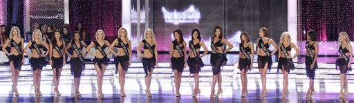 "<div class=""meta ""><span class=""caption-text "">The first fifteen finalists stand on stage after walking in the swim suit competition during the Miss America pageant, Saturday, Jan. 15, 2011 in Las Vegas. (AP Photo/Julie Jacobson) (AP Photo/ Julie Jacobson)</span></div>"