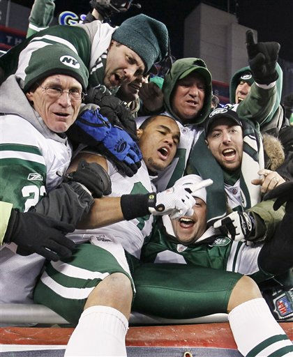 New York Jets tight end Dustin Keller celebrates with fans after the Jets&#39; 28-21 win over the New England Patriots in an NFL divisional playoff football game in Foxborough, Mass., Sunday, Jan. 16, 2011.  &#40;AP Photo&#47;Winslow Townson&#41; <span class=meta>(AP Photo&#47; Winslow Townson)</span>