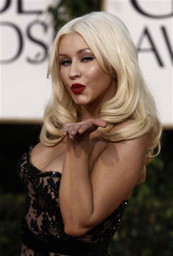 """<div class=""""meta image-caption""""><div class=""""origin-logo origin-image """"><span></span></div><span class=""""caption-text"""">FILE - In this Jan. 16, 2011 file photo, singer Christina Aguilera arrives for the Golden Globe Awards in Beverly Hills, Calif. Aguilera will sing the national anthem at the Super Bowl in Texas on Feb. 6. (AP Photo/Matt Sayles, file) (AP Photo/ Matt Sayles)</span></div>"""