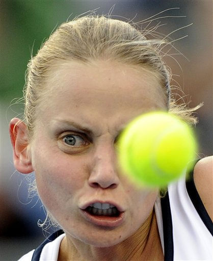 "<div class=""meta ""><span class=""caption-text "">Australia's Jelena Dokic eyes on the ball as she plays Zuzana Ondraskova of the Czech Republic during their first round match at the Australian Open tennis championships in Melbourne, Australia, Monday, Jan. 17, 2011.   (AP Photo/Andrew Brownbill) (AP Photo/ Andrew Brownbill)</span></div>"
