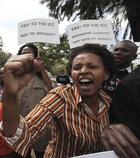 "<div class=""meta ""><span class=""caption-text "">Kenyan protesters hold placards as they shouts slogans during a protest in Nairobi. Scores of protesters gathered at Freedom Corner in Nairobi, Kenya Tuesday, Jan. 18, 2011 to begin a campaign to collect 1 million signatures in support of the International Criminal Court. ICC Prosecutor Luis Moreno Ocampo has publicly named six high-ranking government officials and prominent Kenyans as the people who bear the greatest responsibility for violence that followed the December 2007 election in which more than 1,000 people were killed.(AP Photo/Sayyid Azim) (AP Photo/ Sayyid Azim)</span></div>"