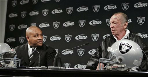 New Oakland Raiders coach Hue Jackson, left, and Raiders owner Al Davis, right, chat at a news conference at the NFL football team&#39;s headquarters in Alameda, Calif., Tuesday, Jan. 18, 2011. &#40;AP Photo&#47;Paul Sakuma&#41; <span class=meta>(AP Photo&#47; Paul Sakuma)</span>