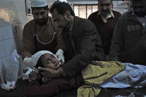 A Pakistani student injured in a bomb explosion receives treatment at Lady Reading hospital in Peshawar, Pakistan, Wednesday, Jan. 19, 2011. A bomb exploded outside a school  in a residential area of Peshawar city on Wednesday, killing at least one person and wounding 14 others. &#40;AP Photo&#47;Mohammad Iqbal&#41; <span class=meta>(AP Photo&#47; Mohammad Iqbal)</span>