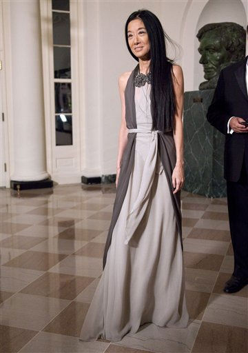 "<div class=""meta image-caption""><div class=""origin-logo origin-image ""><span></span></div><span class=""caption-text"">Designer Vera Wang arrives at the White House in Washington, Wednesday, Jan. 19, 2011, for a state dinner in honor of Chinese President Hu Jintao. (AP Photo/Evan Vucci) (AP Photo/ Evan Vucci)</span></div>"