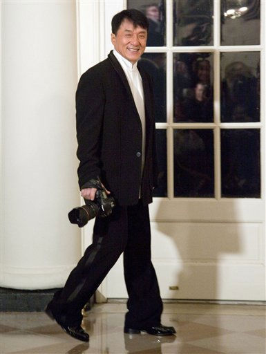 "<div class=""meta image-caption""><div class=""origin-logo origin-image ""><span></span></div><span class=""caption-text"">Actor Jackie Chan arrives at the White House in Washington, Wednesday, Jan. 19, 2011, carrying a camera for a state dinner in honor of China's President Hu Jintao. (AP Photo/Evan Vucci) (AP Photo/ Evan Vucci)</span></div>"