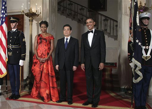 "<div class=""meta image-caption""><div class=""origin-logo origin-image ""><span></span></div><span class=""caption-text"">President Barack Obama and first lady Michelle Obama stand with China's President Hu Jintao at the Grand Staircase as they arrive for a state dinner at the White House in Washington, Wednesday, Jan. 19, 2011. (AP Photo/Carolyn Kaster) (AP Photo/ Carolyn Kaster)</span></div>"