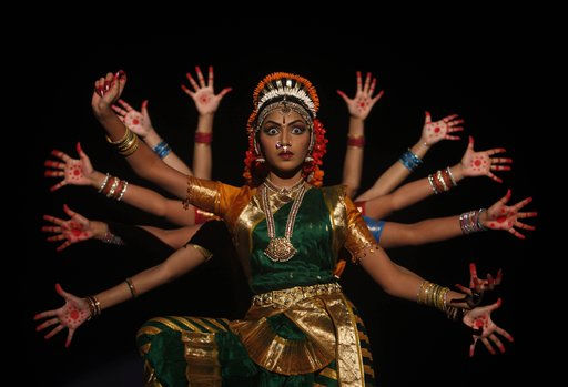 In this photo taken on Thursday, Jan. 20, 2011, Indian artists perform the classical Kuchipudi dance during a cultural event in Hyderabad, India. The Kuchipudi is a classical dance from the southern Indian state of Andhra Pradesh. &#40;AP Photo&#47;Mahesh Kumar A.&#41; <span class=meta>(AP Photo&#47; Mahesh Kumar A)</span>