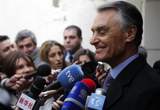 Portuguese President Anibal Cavaco Silva smiles while talking to journalists after voting in Portugal&#39;s presidential election Sunday, Jan. 23, 2011 in Lisbon.  Cavaco Silva is running for a second term. &#40;AP Photo&#47;Armando Franca&#41; <span class=meta>(AP Photo&#47; Armando Franca)</span>
