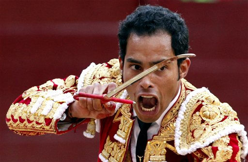 Colombia&#39;s bullfighter Luis Bolivar prepares to kills a bull with his sword during a bullfight in the Santamaria bullring in Bogota, Colombia, Sunday Jan. 23, 2010. &#40;AP Photo&#47;Fernando Vergara&#41; <span class=meta>(AP Photo&#47; Fernando Vergara)</span>