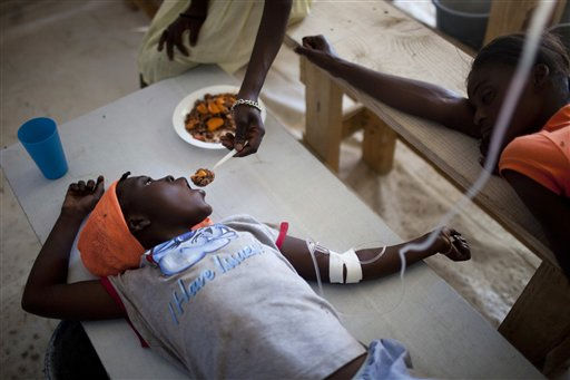 "<div class=""meta ""><span class=""caption-text "">Janika Faneus is fed by her mother while receiving treatment for cholera at a MSF, Doctors Without Borders cholera clinic in Saint-Marc, Haiti, Saturday Jan. 22, 2011. The cholera epidemic that killed nearly 4,000 people, is claiming fewer victims, with a sharp drop in new cases everywhere from the Artibonite Valley to the crowded urban slums.  (AP Photo/Rodrigo Abd) (AP Photo/ Rodrigo Abd)</span></div>"