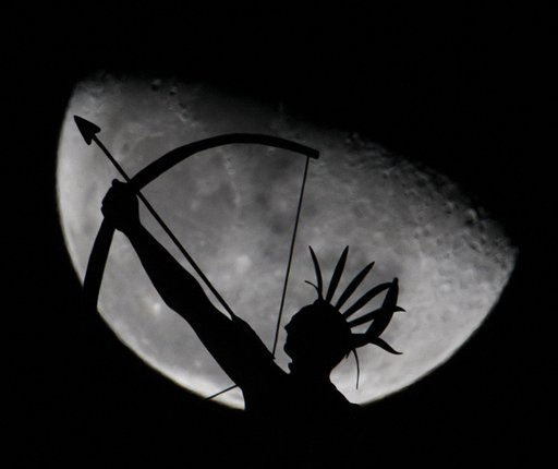 A statue of a Kansa Indian is silhouetted against the rising moon as it stands atop the Kansas State Capitol building in Topeka, Kan. Tuesday, Jan. 25, 2009. Kansas will celebrate its sesquicentennial with a series of events starting on Kansas Day Jan. 29. &#40;AP Photo&#47;Charlie Riedel&#41; <span class=meta>(AP Photo&#47; Charlie Riedel)</span>