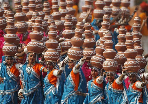 Indian schoolchildren perform a Rajasthan folk dance at the Republic Day parade in New Delhi, India, Wednesday, Jan. 26, 2011. The day marks the anniversary of India&#39;s adoption of a democratic constitution. &#40;AP Photo&#47;Gurinder Osan&#41; <span class=meta>(AP Photo&#47; Gurinder Osan)</span>