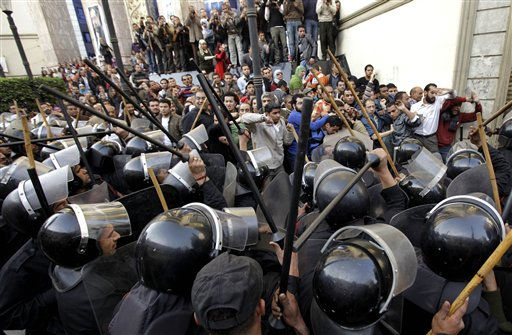 "<div class=""meta image-caption""><div class=""origin-logo origin-image ""><span></span></div><span class=""caption-text"">Egyptian anti-riot police confront Egyptian activist outside a journalists syndicate in downtown Cairo, Egypt, Wednesday, Jan. 26, 2011. A small gathering of Egyptian anti-government activists tried to stage a second day of protests in Cairo Wednesday in defiance of a ban on any gatherings, but police quickly moved in and used force to disperse the group. (AP Photo/Ben Curtis) (AP Photo/ Ben Curtis)</span></div>"