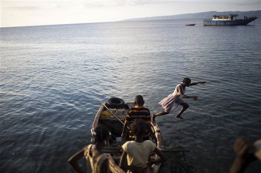 "<div class=""meta ""><span class=""caption-text "">A girl jumps from a boat into the ocean in Port-du-Paix, Haiti, Thursday, Jan. 27, 2011. ( AP Photo/Rodrigo Abd) (AP Photo/ Rodrigo Abd)</span></div>"