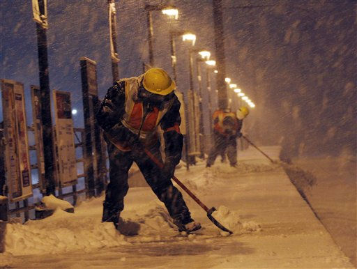 Workers clear a platform at the Edison train station as snow falls during a storm late Wednesday, Jan. 26, 2011 in Edison, N.J. &#40;AP Photo&#47;Mel Evans&#41; <span class=meta>(AP Photo&#47; Mel Evans)</span>