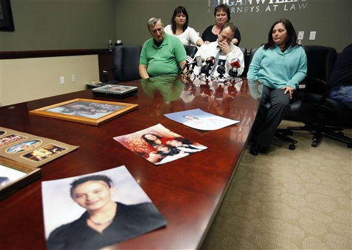 FILE -  In this Jan. 27, 2011 file photo, family members Mark Szpila, front center, Elmer Barthelemy, front left, Lynn Barthelemy, front right, Dawn Barthelemy, back left, and Susan Szpila, back center, speak about Melissa Barthelemy, pictured in family photographs on the desk, during a news conference in Amherst, N.Y.  Barthelemy was one of four women whose bodies were dumped along a desolate beachfront strip on Long Island. Authorities say all were prostitutes who booked their clients online and were probably slain by a serial killer. &#40;AP Photo&#47;David Duprey, File&#41; <span class=meta>(AP Photo&#47; David Duprey)</span>