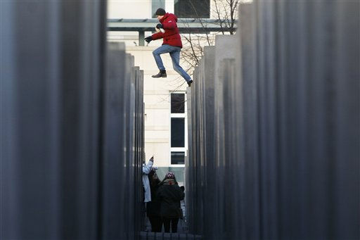 A man jumps between columns as part of the 2711 concrete slabs of the Holocaust Memorial on the international Holocaust remembrance day in Berlin, Germany, on Thursday, Jan. 27, 2011. &#40;AP Photo&#47;Markus Schreiber&#41; <span class=meta>(AP Photo&#47; Markus Schreiber)</span>