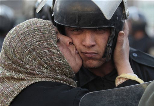"<div class=""meta image-caption""><div class=""origin-logo origin-image ""><span></span></div><span class=""caption-text"">An Egyptian anti-government activist kisses a riot police officer following clashes  in Cairo, Egypt, Friday, Jan. 28, 2011. Tens of thousands of anti-government protesters poured into the streets of Egypt Friday, stoning and confronting police who fired back with rubber bullets and tear gas in the most violent and chaotic scenes yet in the challenge to President Hosni Mubarak's 30-year rule. (AP Photo/Lefteris Pitarakis) (AP Photo/ Lefteris Pitarakis)</span></div>"