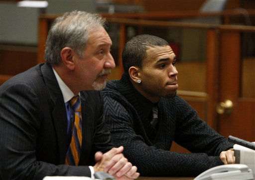 R&#38;B singer Chris Brown appears with his attorney Mark Geragos for a progress report hearing in Los Angeles, Friday, Jan. 28, 2011. Brown pleaded guilty to assaulting his pop star girlfriend Rihanna in Hancock Park after a pre-Grammy Awards party in 2009. He was sentenced to five years probation, ordered to complete 180 days of community labor and a year of domestic violence counseling. &#40;AP Photo&#47;David McNew, Pool&#41; <span class=meta>(AP Photo&#47; David McNew)</span>