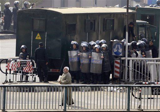 An elderly Egyptian man walks past anti-riot policemen over a bridge in Cairo, Egypt, Friday, Jan. 28, 2011. Egyptian activists protested for a fourth day as social networking sites called for a mass rally in the capital Cairo after Friday prayers, keeping up the momentum of the country&#39;s largest anti-government protests in years. &#40;AP Photo&#47;Amr Nabil&#41; <span class=meta>(Photo&#47;Amr Nabil)</span>