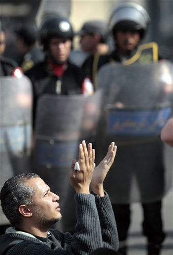 An Egyptian protesters prays in front of anti-riot police in Cairo, Egypt, Friday, Jan. 28, 2011. Egyptian activists protested for a fourth  day as social networking sites called for a mass rally in the capital Cairo after Friday prayers, keeping up the momentum of the country&#39;s largest anti-government protests in years. &#40;AP Photo&#47; Lefteris Pitarakis&#41; <span class=meta>(AP Photo&#47; Lefteris Pitarakis)</span>
