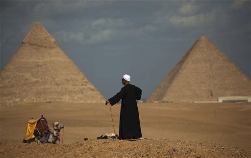 "<div class=""meta ""><span class=""caption-text "">Egyptian camel driver Gamal, 54, waits for tourists near the pyramids, in Giza, Egypt, Monday, Jan. 31, 2011. The pyramids are closed to tourists. A coalition of opposition groups called for a million people to take to Cairo's streets Tuesday to demand the removal of President Hosni Mubarak. (AP Photo/Emilio Morenatti) (AP Photo/ Emilio Morenatti)</span></div>"