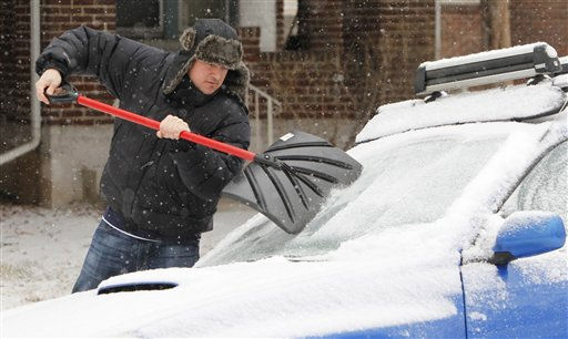 Tom Gillian uses a snow shovel to scrape ice from the windshield of his car in Denver Monday, Jan. 31, 2011. A front moved through the state early Monday morning bringing with it freezing rain, snow and cold. &#40;AP Photo&#47;Ed Andrieski&#41; <span class=meta>(AP Photo&#47; Ed Andrieski)</span>