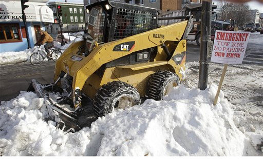 A snow removal crew cleans up the street in the Southie neighborhood of Boston, Monday, Jan. 31, 2011. The area is expecting another mid-week winter storm. &#40;AP Photo&#47;Stephan Savoia&#41; <span class=meta>(AP Photo&#47; Stephan Savoia)</span>