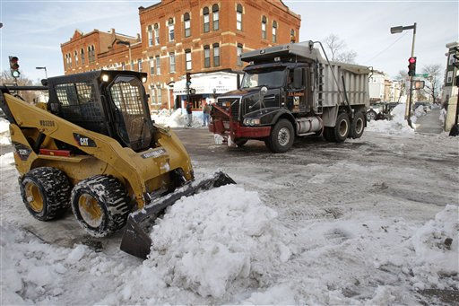 A snow removal crew cleans up the street in the Southie neighborhood of Boston, Monday afternoon, Jan. 31, 2011. The area is expecting another mid-week winter storm. &#40;AP Photo&#47;Stephan Savoia&#41; <span class=meta>(AP Photo&#47; Stephan Savoia)</span>