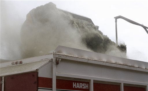 Dust swirls as hay is loaded into a mixer to prepare feed at Bob Funk&#39;s Express Ranches in El Reno, Okla., Monday, Jan. 31, 2011, in preparation for an anticipated winter storm. Workers are preparing enough feed to last their animals for 48 hours. &#40;AP Photo&#47;Sue Ogrocki&#41; <span class=meta>(AP Photo&#47; Sue Ogrocki)</span>