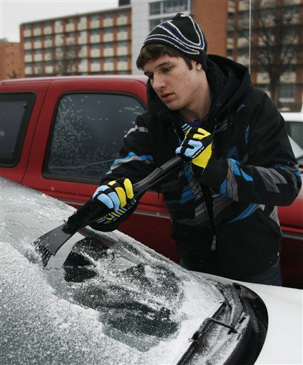 University of Kansas student Kolby Botts, from Wichita, chips ice off the windshield of his vehicle as freezing rain begins to fall in Lawrence, Kan., Monday, Jan. 31, 2011. The area is under a winter weather warning and a blizzard warning. &#40;AP Photo&#47;Orlin Wagner&#41; <span class=meta>(AP Photo&#47; Orlin Wagner)</span>