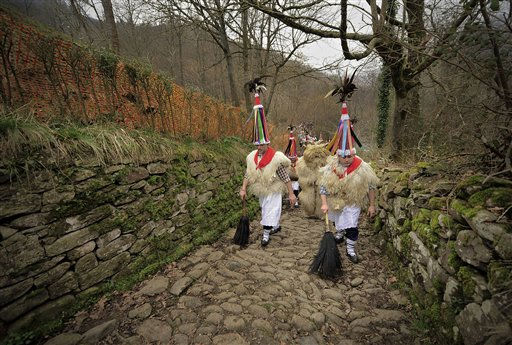 Men dressed in sheepskin costumes for a carnival celebration walk on the way to the Pyrenees village of Ituren, northern Spain, Monday, Jan.31, 2011. The tradition is to march through the village every year in a ritual to purify the harvest land from evil spirits and to welcome the coming Spring. &#40;AP Photo&#47;Alvaro Barrientos&#41; <span class=meta>(AP Photo&#47; Alvaro Barrientos)</span>