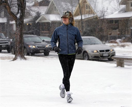 A woman jogs in the snow and cold in Washington Park in Denver Monday, Jan. 31, 2011. A front moved through the state early Monday morning bringing with it freezing rain, snow and cold. &#40;AP Photo&#47;Ed Andrieski&#41; <span class=meta>(AP Photo&#47; Ed Andrieski)</span>