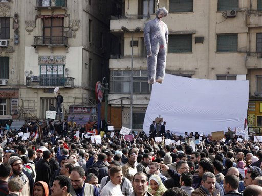 An effigy of Egyptian President Hosni Mubarak hangs over demonstrators in Tahrir, or Liberation, Square in Cairo, Egypt, Tuesday, Feb. 1, 2011. Tens of thousands of people flooded into the heart of Cairo Tuesday, filling the city&#39;s main square as a call for a million protesters was answered by the largest demonstration in a week of unceasing demands for President Hosni Mubarak to leave after nearly 30 years in power. &#40;AP Photo&#47;Victoria Hazou&#41; <span class=meta>(AP Photo&#47; Victoria Hazou)</span>