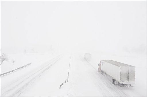 Semi-trucks disappear into the white snow as they travel along I-70 Tuesday, Feb. 1, 2011, near Boonville, Mo. Potentially the worst winter storm to hit Missouri in decades began its trek across the state Tuesday, dumping more than a foot of snow while delivering freezing rain, blustering winds and dangerously cold temperatures. &#40;AP Photo&#47;L.G. Patterson&#41; <span class=meta>(AP Photo&#47; L.G. Patterson)</span>