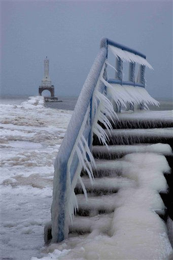 "<div class=""meta ""><span class=""caption-text "">Icicles form on a walkway along Lake Michigan in Port Washington, Wis., Tuesday, Feb. 1, 2011. (AP Photo/Jeffrey Phelps) (AP Photo/ Jeffrey Phelps)</span></div>"