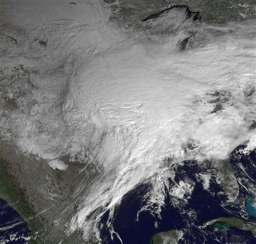 This satellite image provided by NOAA and taken Tuesday Feb. 1, 2011 at 10:45 EST shows a huge swath of the United States affected by a winter storm that has already brought layers of dangerous ice and blowing snow, closing roads and airports from Texas to Rhode Island. The storm&#39;s more than 2,000-mile reach threatened to leave about a third of the nation covered in a hodge-podge of harsh weather. Ice fell first and was expected to be followed by up to two feet of snow in some places.  &#40;AP Photo&#47;NOAA&#41; <span class=meta>(AP Photo&#47; Anonymous)</span>