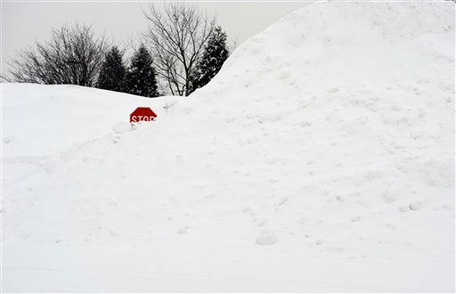 A stop sign pokes out of a large pile of snow at the end of a street in Enfield, Conn., Tuesday, Feb. 1, 2011.  &#40;AP Photo&#47;Jessica Hill&#41; <span class=meta>(AP Photo&#47; Jessica Hill)</span>