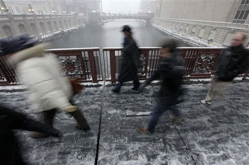 Pedestrians make their way across the Madison St. bridge, Tuesday, Feb. 1, 2011, in Chicago as a blizzard moves into Illinois.  Commuters, corporate executives and government officials braced for a storm of proportions that haven&#39;t been seen in decades _ one that could dump as much as 2 feet of snow and whip up 25-foot waves along Lake Michigan before moving on. &#40;AP Photo&#47;M. Spencer Green&#41; <span class=meta>(AP Photo&#47; M. Spencer Green)</span>