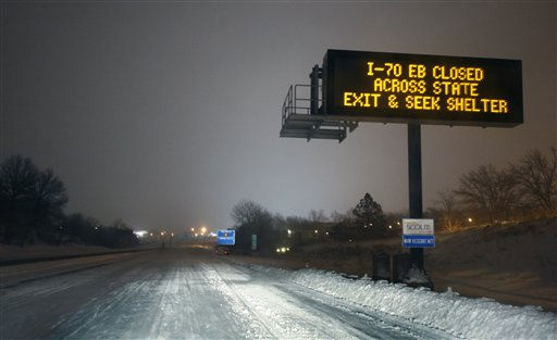 "<div class=""meta image-caption""><div class=""origin-logo origin-image ""><span></span></div><span class=""caption-text"">A Kansas City Scout sign warns motorists along I-70 near Kansas City, Mo., Tuesday, Feb. 1, 2011. I-70 was closed from Kansas City to St. Louis because of heavy snow. The area is under a blizzard warning until Wednesday. (AP Photo/Orlin Wagner) (AP Photo/ Orlin Wagner)</span></div>"