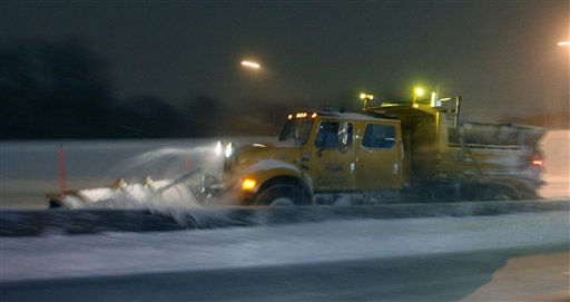 A Missouri Department of Transportation plow clears snow along I-70 near Kansas City, Mo., Tuesday, Feb. 1, 2011. I-70 was closed from Kansas City to St. Louis because of heavy snow. The area is under a blizzard warning. &#40;AP Photo&#47;Orlin Wagner&#41; <span class=meta>(AP Photo&#47; Orlin Wagner)</span>