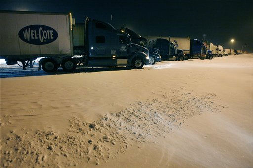 Snow drifts around trucks at a rest area along I-70 near Lawrence, Kan., Tuesday, Feb. 1, 2011. The area is under a blizzard warning until Wednesday morning. &#40;AP Photo&#47;Orlin Wagner&#41; <span class=meta>(AP Photo&#47; Orlin Wagner)</span>