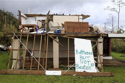 A message sprayed on debris shows the spirit of a home-owner after the building was destroyed in Tully, Australia, Thursday, Feb. 3, 2011, after Cyclone Yasi brought heavy rain and howling winds gusting to 186 mph &#40;300 kph&#41;. The massive cyclone struck northeastern Australia early Thursday, tearing off roofs, toppling trees and cutting electricity - the most powerful storm to hit the area in nearly a century. &#40;AP Photo&#47;Rick Rycroft&#41; <span class=meta>(AP Photo&#47; Rick Rycroft)</span>