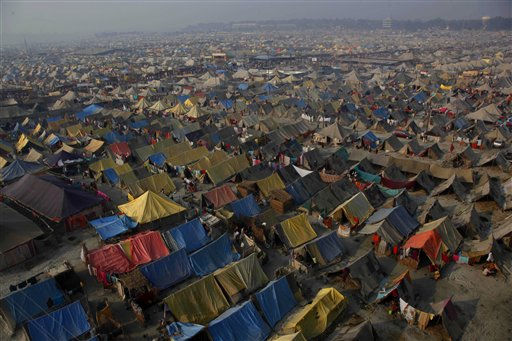 "<div class=""meta ""><span class=""caption-text "">Tents stand erected, set up as makeshift homes for Hindu devotees participating in the annual Magh Mela festival, on the banks of the Sangam, the confluence of rivers Ganges and Yamuna, in Allahabad, India, Thursday, Feb. 3, 2011. Hundreds of thousands of Hindu pilgrims take dips in the confluence in the hope of washing away their sins, during the month long festival. (AP Photo/Rajesh Kumar Singh) (AP Photo/ Rajesh Kumar Singh)</span></div>"