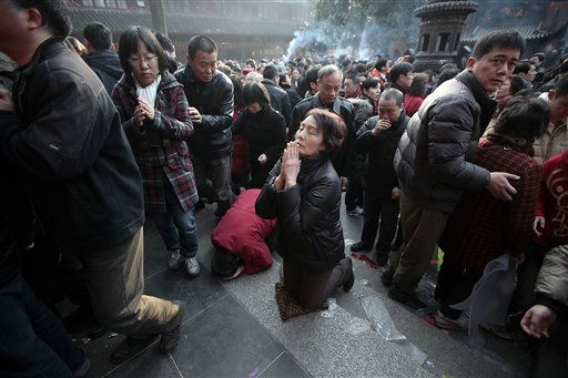 Worshippers offer the first prayer of the new year at a temple Thursday, Feb. 3, 2011, in Shanghai, China. According to the Chinese zodiac, the Year of 2011 is the Year of the Rabbit. &#40;AP Photo&#47;Eugene Hoshiko&#41; <span class=meta>(AP Photo&#47; Eugene Hoshiko)</span>