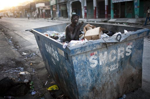 A mentally ill man sits inside a trash container in Port-au-Prince, Haiti, Thursday, Feb. 3, 2011. &#40;AP Photo&#47;Rodrigo Abd&#41; <span class=meta>(AP Photo&#47; Rodrigo Abd)</span>